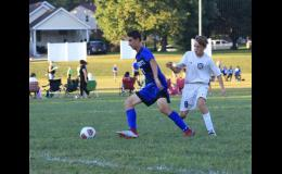 Anna-Jonesboro/Cobden's Noah Treece, in dark uniform, moves the ball against Harrisburg. Photo provided.