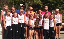 The Lick Creek School Lady Eagles cross country team celebrates a second consecutive state championship. Photo provided.