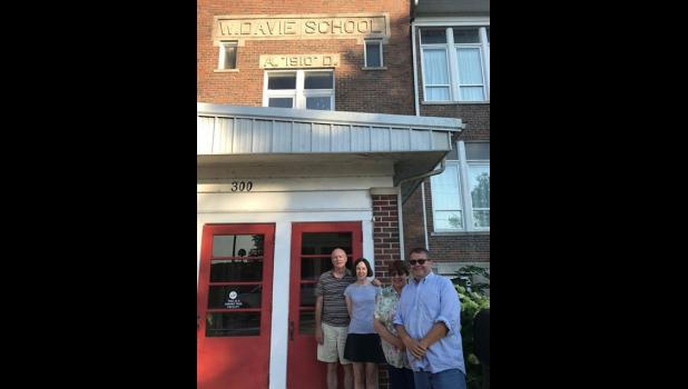 The new owners of The Davie School Inn in Anna, Tammy and Lyle Woodrum, right, only charged $1 to their first customers, Jim and Debra May, left, of Plano, Texas. The Woodrums took over the business on June 29. Photo provided.