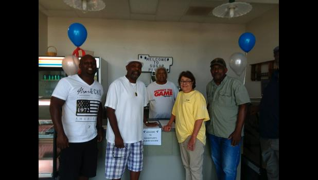 Restaurant owner Wilburt Fowler (center) met with new customers and old friends at the grand opening of Sugar Plums Country Cooking restaurant in Mounds. Photo provided.