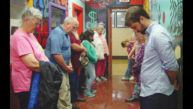 First Christian Church prayed in a hallway at A-JCHS on Aug. 16. Photo by Amber Skelton.