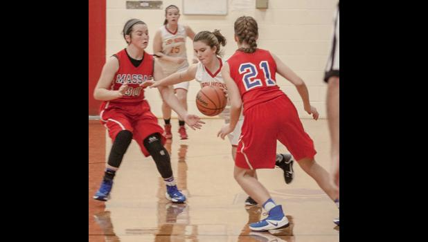 Anna Junior High School's Avery Page drives with the ball through two Massac County players. The junior high school basketball action was captured during a Jan. 3 game in Anna. Photo by Tiffiny Dillow for The Gazette-Democrat.