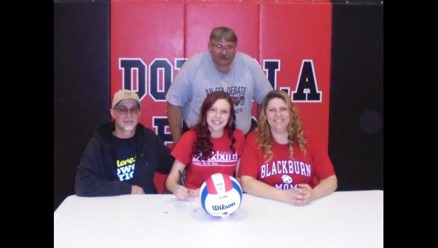 Seated, from left, are Karlie's father, Sean, Karlie and her mother Sarah. Dongola athletics director and volleyball coach Preston Hall is standing. Photo by Mike Estel.