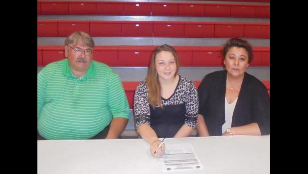 From left are Dongola athletic's director and volleyball coach Preston Hall, Kaysee and her mother, Mary Bridges. Photo by Mike Estel.