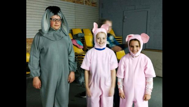 """Cindy Wright created and made the costumes for the play """"Scenes from Pooh."""" Eeyore (Anthony Jimenez) and Piglets (Brinley Corbit and Kenzie Stover)  are showing off their costumes. Photo provided."""