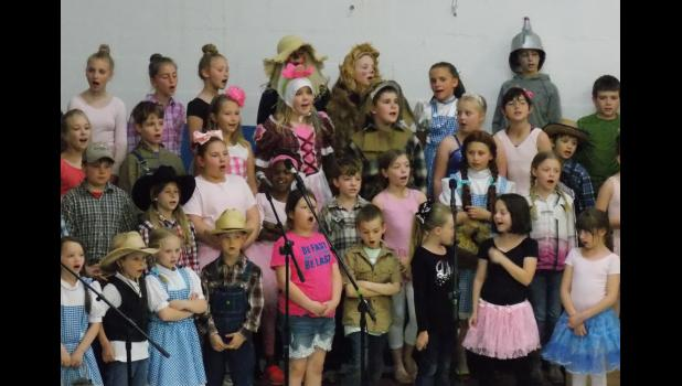 """Lick Creek School students in grades 1 through 5 sang """"Somewhere Over the Rainbow"""" to close out """"The Wizard of Oz""""-themed show which was performed for visiting grandparents. Photo by Benjamin Marxer."""
