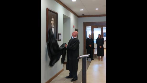 Union County Presiding Judge Mark Boie unveiled the portrait of Abraham Lincoln.