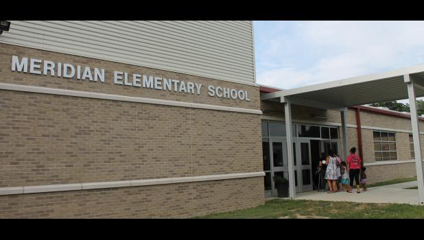 Visitors enter the new Meridian Elementary School in Mounds during an open house on Thursday, Aug. 10. Photo by Lindsey Rae Vaughn.