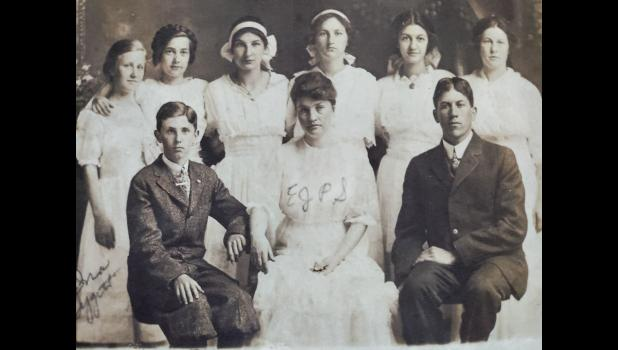 This postcard was given to PAST by an unknown donor. It is believed to be an 8th grade class with EJPS (Ella Jane Pickles Sanders), from about 1900. Names on the back of the photograph include: 1. Ina Tygett, 2. Helen Lence, 3. Jenny Lanier Jones, 4. It's P____ (Watkins), 5. Zelma ____ Dillow, 6. Bertie Hunsaker. Don Morgan, EJPS, unknown man. Readers who recognize any subject are asked to share their information with PAST. Photo provided.