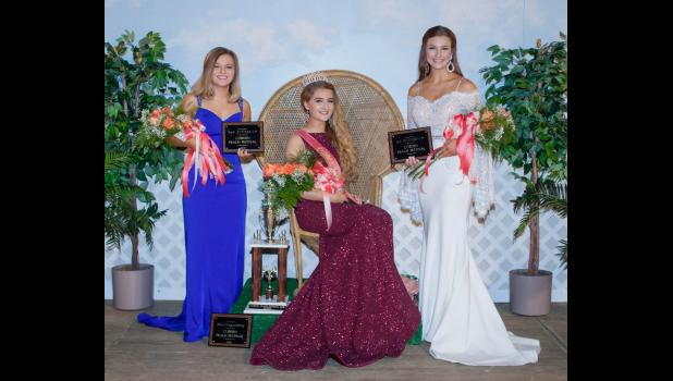 The 2018 Cobden Peach Festival queen and her court were named last Saturday night. From left are Zoe Fuhrhop of Cobden, who was second runner-up and Miss Congeniality; Grace Pitts of Cobden, the new 2018 queen; and Addison Osman of Anna, the first runner-up. Photo by Tiffiny Dillow for The Gazette-Democrat.