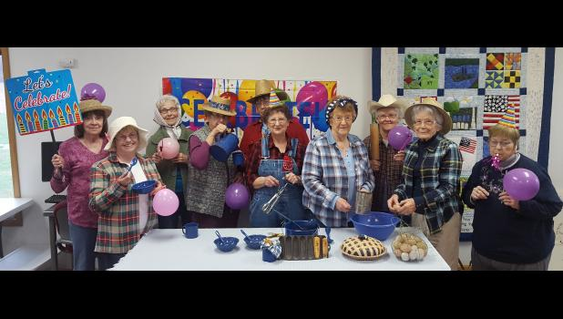 Members of the Pulaski-Alexander board of the Illinois Association of Home and Community Education are busy preparing for an upcoming Hillbilly Dinner Theater. Photo provided.