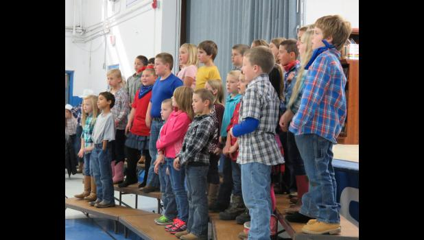 Second and 3rd graders continued the country theme of the program in their songs. Photo by Amber Skelton.