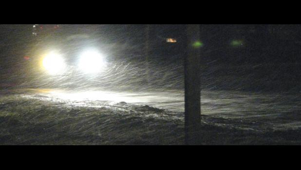 Motorists found themselves driving through snow showers Monday night. The picture was taken in Anna.