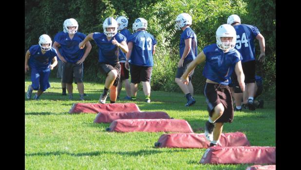 A-J football players ran through a drill Monday evening.
