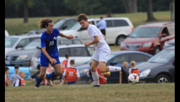 A-J/Cobden/Dongola player Jaryt Tripp advances the ball against a Carterville defender.