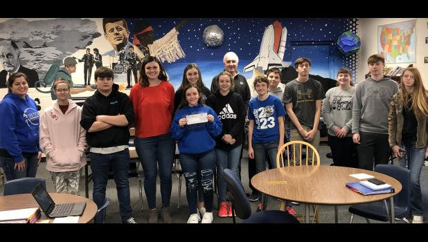 Anna-Jonesboro Community High School teacher Amy Penninger has received a Southern Illinois Electric Cooperative's, SIEC, Touchstone Energy Classroom Empowerment Grant for $500. The photograph features Penninger and her third hour geography class at the Union County school, along with Chris Boyd from SIEC. Photo provided.