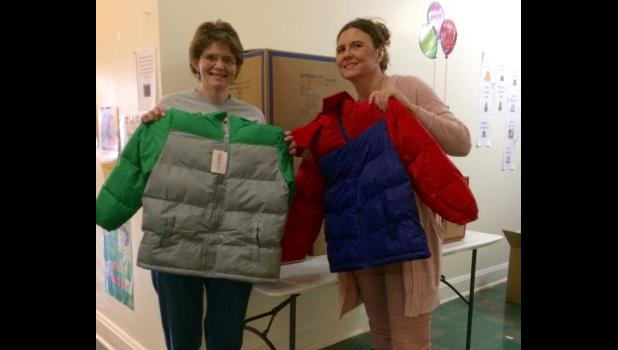 Anna Head Start received many child size coats. From left are WIBH sales manager Shawnna Rhine with Patty Perry of Head Start. Photo provided.