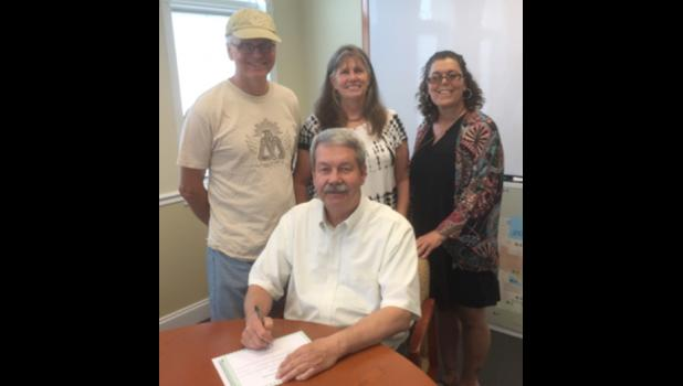 Anna Mayor Steve Hartline has signed a proclamation designating June 8-9 as Annabelle Days in the Union County community. Those on hand for the signing included, standing, from left, event co-chairs Tom Sadowski and Shari Sadowski, and Bonni Littleton, representing the Union County Chamber of Commerce and a member of the festival committee. Photo provided.