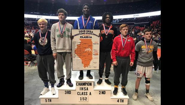Arieh Hart stands on the podium after winning a state wrestling championship. Photos provided.