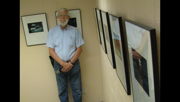 Charles Swedlund greeted visitors who attended an exhibit of his photographs last Saturday afternoon in Cobden.