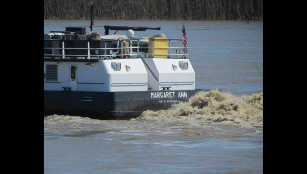 Muddy brown water churned as the towboat Margaret Ann (Port of New Orleans, La.) made its way north on the Mississippi.