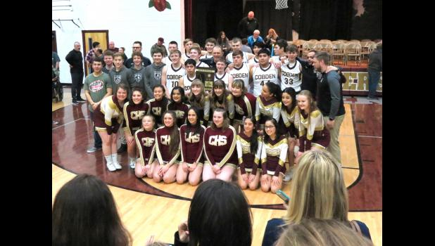 The host Cobden High School boys' basketball team defeated Cairo last Friday night to win an Illinois High School Association Class 1A postseason regional championship title. The win gave Cobden its first regional title in nearly 60 years. The team's players and coaches were joined by cheerleaders and the many fans who packed into the Cobden High School gym for Friday night's game to celebrate the championship.