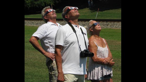 A number of Cobden locals and visitors viewed the solar eclipse from the park in downtown Cobden. Photo by Geof Skinner.