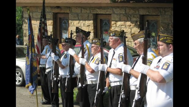 """An honor guard from the Veterans of Foreign Wars Carroll P. Foster Post No. 3455 of Anna stands at attention while """"Taps"""" was being played during a Memorial Day service held Monday morning at the Cobden Cemetery in Cobden."""