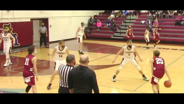 Cobden, in white uniforms, hosted Century in boys' high school basketball action Thursday, March 11. Cobden won the game and continued on its way to an unbeaten season. The image was captured from a video of the game which was posted online.