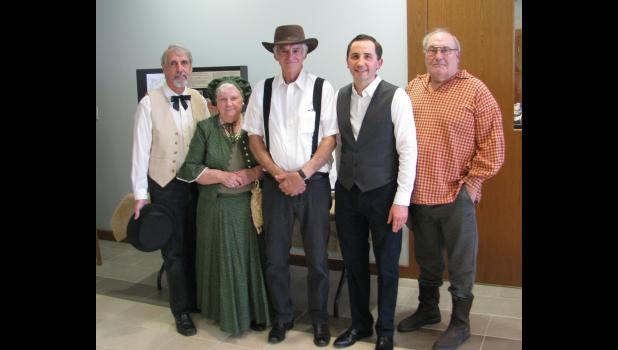 Union County residents helped to bring history to life during last Saturday afternoon's bicentennial celebration. From left are Darryl Parks, who portrayed Thomas Cox, one of Union County's first commissioners; Lillian Milam, who portrayed the wife of early settler and statesman John Grammer; Mike Estel, who portrayed early settler George Wolf (or Woolf), who also was one of the county's first commissioners; Union County State's Attorney Tyler R. Edmonds, who portrayed Illinois territorial Gov. Ninian Edwar