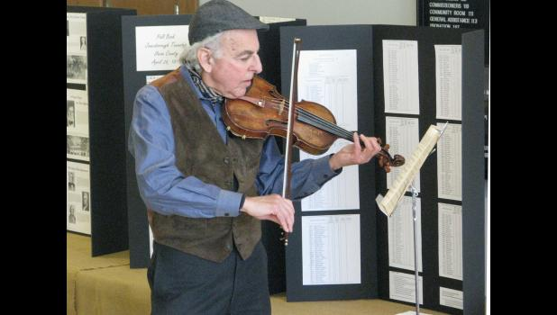 Marshall Poger of Webster Groves performed old-time music at the celebration.