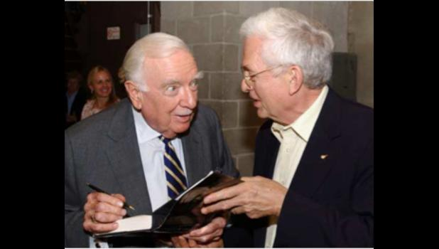 Walter Cronkite, left, was interviewed by Don Michel in Carbondale in 1996. SIU Press Photo/courtesy of Don Michel.