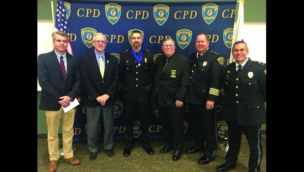 Those present at an awards presentation in Carbondale on July 25 included, from left, Carbondale City Manager Gary Williams, Mayor Mike Henry, Sgt. Guy Draper, FOP awards chairperson Jerry Lieb, Police Chief Jeff Grubbs and Deputy Chief Stan Reno. Photo courtesy of FOP.