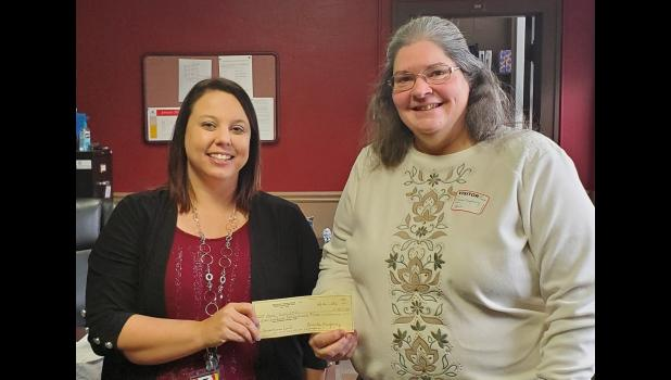Eastern Star representative Brenda Mayberry, right, delivered a $1,500 donation to Anna School District No. 37 superintendent Dr. Julie Bullard for the district's benevolence fund. Photo provided.