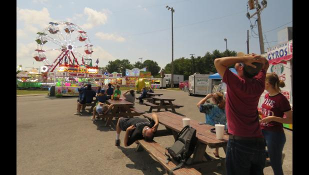 Spectators viewed the solar eclipse from different parts of the Union County Fair at the Anna City Park in Anna. Photo by Amber Filbeck.