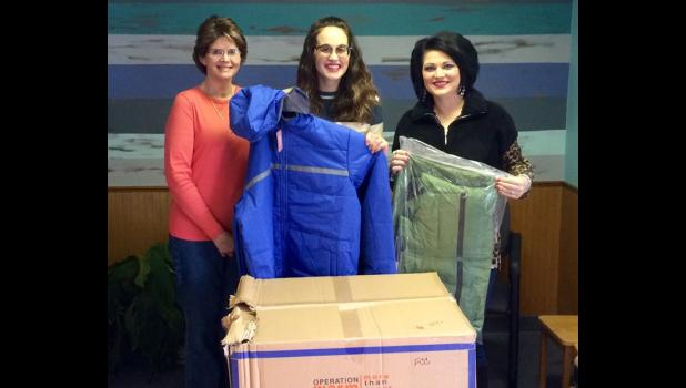 Family Counseling Center, FCC, in Vienna received several adult sized coats as part of this year's NCNH Campaign. From left are WIBH sales manager Shawnna Rhine, FCC administrative staff member Kara Lawrence and SMTD operations manager Tiffany Ray. Photo provided.