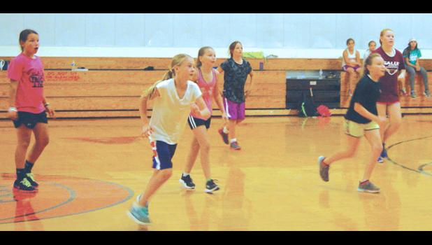 The girls competed Wednesday afternoon in a game that combined football and basketball.