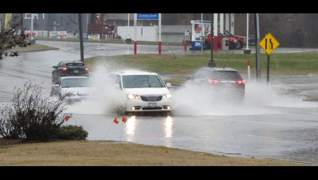 Vehicles made their way through high water in the 500 block of East Vienna Street in Anna. The photograph was taken when heavy rain fell in early January of this year. File photo.