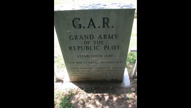 A monument honoring Civil War veterans stands in the Grand Army of the Republic plot at the Cobden Cemetery.