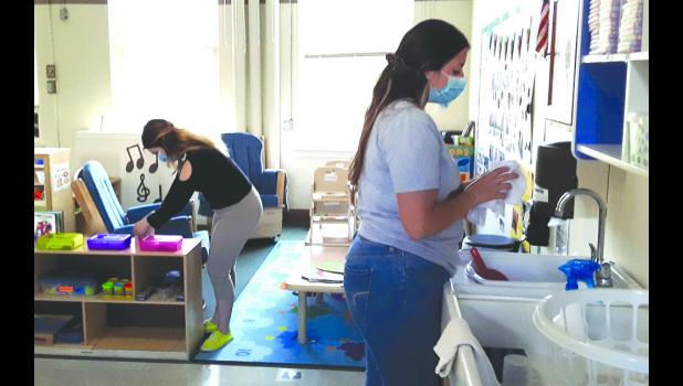 Southern Seven Early Head Start teachers Hortensia Zamora and Marissa Melot prepare a classroom at Anna Head Start for the return of children in the coming weeks. Photo provded.