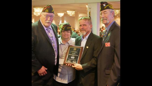 Award presented Lonnie Hinton, second from right, was presented with the 2017-2018 News Media Professional of the Year award at the Illinois VFW's 97th annual state convention. Along with Hinton are, from left, state senior vice commander Don Boyer; assistant adjutant-quartermaster Barbara Wilson, who is a life member of the VFW's Carroll P. Foster Post No. 3455 in Anna; and District 15 commander Clarence Caraker, who is a life member of Pulaski County Memorial Post No. 8891 in Mounds. Photo by Rodney Thomp