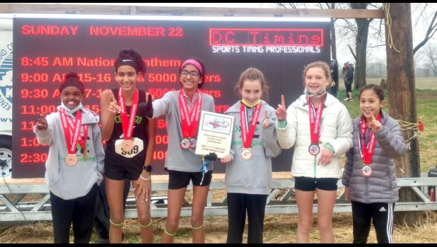 Jadyn Gerardi, left,  of Lick Creek led her team to a national cross country championship at a competition which was held near Lexington, Ky.