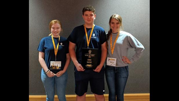 With their award are Service Snapshop project heads Lily Baker, Emily Mowery and Austin Adams. Photo provided.