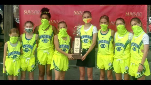 Members of the Jonesboro School cross country team include, from left, Sophia Hill, Melaina Bundren, Aliyah Box, Kinley Leek, Zoe Jones, Kenzie Miller, Reese Jones and Raegan Jones. Photo provided.