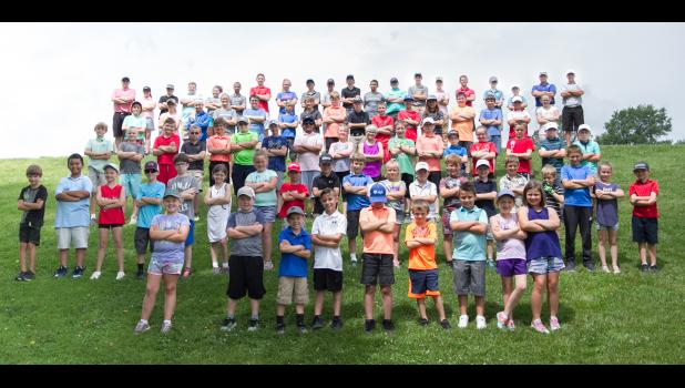 Participants in the junior golf program at the Union County Country Club gathered for a photograph on Monday morning, June 17. Nearly 100 people participated in the camp. Photo by Tiffiny Dillow for The Gazette-Democrat.