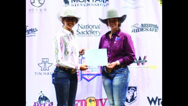 Kelsey McCrite, left, was presented with her $2,000  scholarship by a National Little Britches Rodeo youth board member. Photo provided.