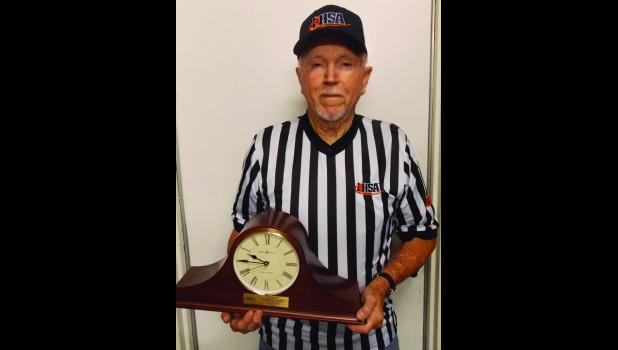 Ken Palmer has been honored by the Illinois High School Association for 60 years of work as a sports official.