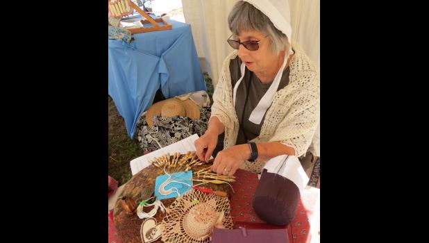 Heartland Lace Guild member Sarah Lewis Meyer of Paducah showed visitors at the encampment how lace was made, the old-fashioned way. She was working on a Bobbin Lace heart ornament.