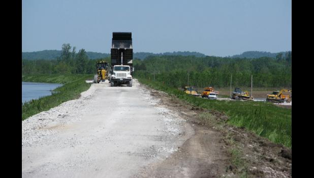 Gravel was placed on a Mississippi River levee road west of Wolf Lake on Saturday, May 6. The Mississippi River is on the left. Local road damage due to recent flooding was addressed at a regular meeting of the Union County Board of Commissioners last Friday in Jonesboro.