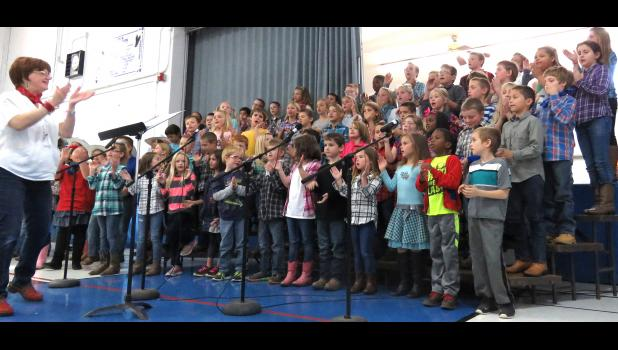 Elizabeth Corbit, left, led students of Lick Creek School in singing for their guests on Grandparents Day events, which were held Nov. 14-15. Photo by Amber Skelton.